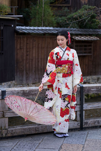 Japanese girl in kimono Japanese Girl Traditional Clothing One Person Kimono Women Robe Architecture Lifestyles Adult Clothing Young Adult Real People Full Length Young Women Building Exterior Females Leisure Activity Outdoors Floral Pattern Beautiful Woman Hairstyle