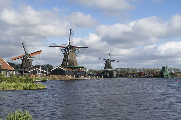 Windmills of the Zaanse Schans a populair historic tourist village in the Netherlands Windmills Landscape Tourist Destination Tourism Netherlands Wind Power Alternative Energy Cloud - Sky Architecture Traditional Windmill Outdoors Built Structure