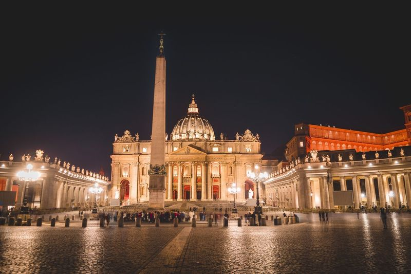 Pope VaticanCity St Peters Basilica Rome Built Structure Building Exterior Architecture Illuminated Night Travel Destinations City Copy Space Building Waterfront Outdoors Sky Water Incidental People Travel Nature Tourism Reflection