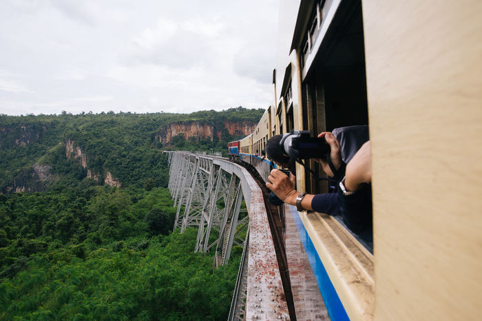 """Everybody knows that it's not safe to have your head outside of window on the moving train, but you do it anyways. Nobody can resist the beautiful view from """"Goteik viaduct"""", the highest bridge and the largest railway trestle in Myanmar. Burma Cloudy Gohteik Viaduct Goteik Viaduct Landscape Maymyo Myanmar On The Train On The Way Railway Railway Track Railway Trestle Shan State Southeastasia Train Traveling Burmese Train Showcase July My Year My View Miles Away"""