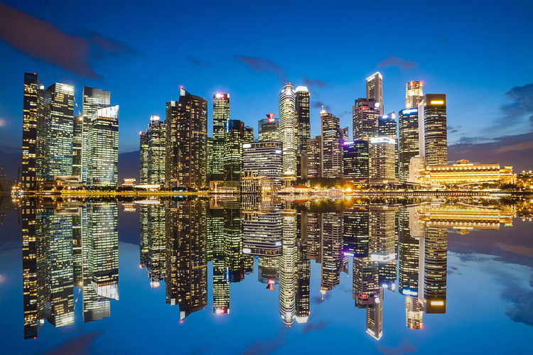 Reflection of illuminated buildings in city