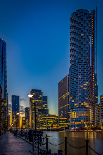 Low angle view of illuminated buildings against clear sky