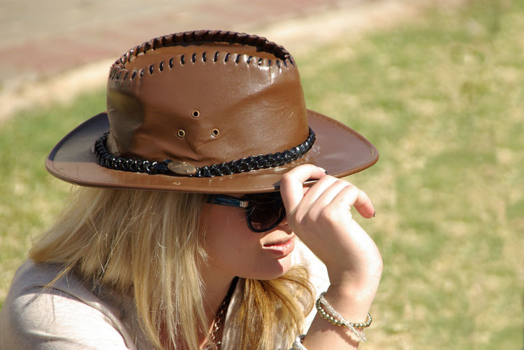 Blond Hair Blonde Girl Blown Leather Hat Hat Hats Hide From The Sun Lifestyles Young Girl With Hat