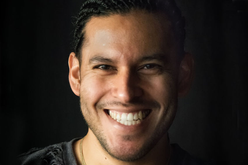 Black Background Cheerful Confidence  Good Mood Happiness Headshot Human Face Looking At Camera One Man Only One Person Portrait Real People Smiling Studio Shot Toothy Smile