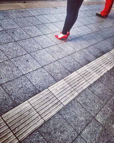 Low Section Human Leg Red Human Body Part Human Foot One Person Day High Angle View Real People Outdoors Lifestyles Standing Women Only Women One Woman Only Nail Polish People Adult Adults Only Streetphotography Street Photography Red Color Shoes Press For Progress The Street Photographer - 2018 EyeEm Awards