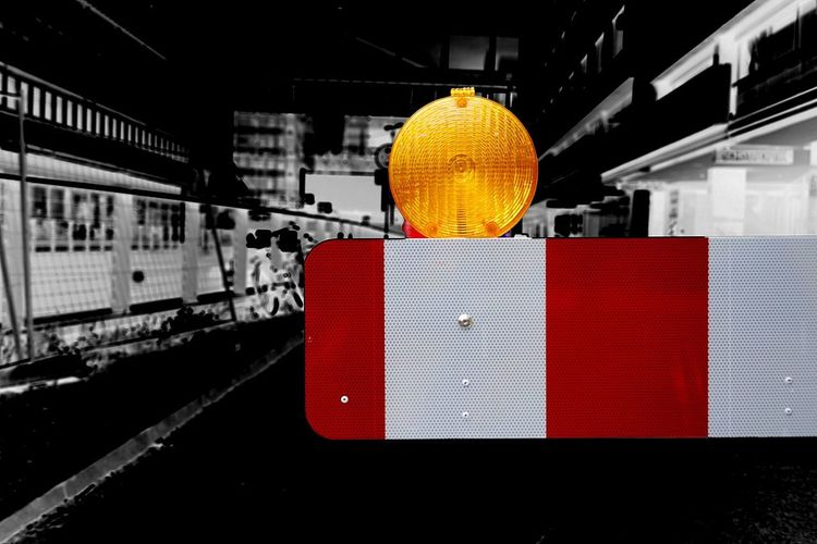 Traffic Barrier Warning Light Architecture Lighting Equipment Built Structure No People Red Orange Color Communication Building Exterior Sign Transportation Road Sign Isolated Color Low Angle View Day Single Object Outdoors