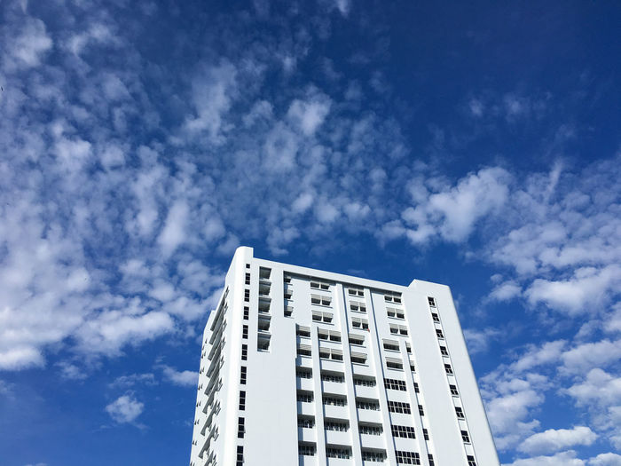 White building with blue sky and cloud background Beauty In Nature Built Structure Sky White Backgrounds Business Architecture City Town Bright