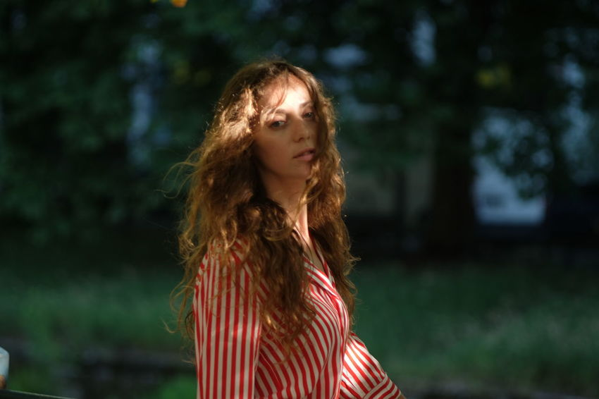summer stroll model Julia Bond Adult Beautiful Woman Beauty Brown Hair Contemplation Focus On Foreground Hair Hairstyle Long Hair Looking Looking At Camera Nature One Person Portrait Redhead Standing Striped Tree Wavy Hair Young Adult