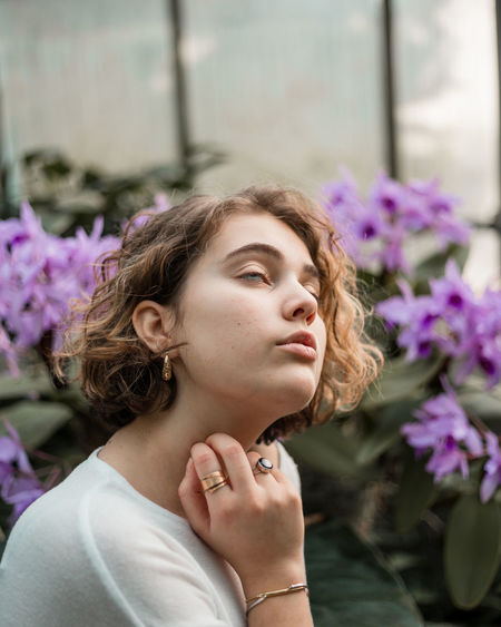 Trinity Blonde Botanical Gardens Fashion Green Color Beautiful Woman Beauty Blond Hair Close-up Contemplation Curly Hair Day Flower Focus On Foreground Fragility Freshness Headshot Leisure Activity Lifestyles Nature Outdoors Purple
