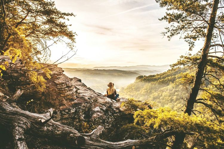 Young Woman Sitting On Mountain
