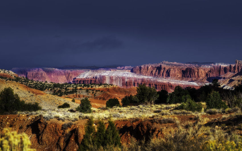 Capitol Reef National Park is a hidden wonder of beauty few people travel to visit. No People Capitol Reef National Park National Parks Adventure Travel Travel Photography Nature Nature Photography Outdoors Outdoor Photography Landscape Landscape Photography Rocks Clouds Colors Desert Sky Scenic View Scenery Trees