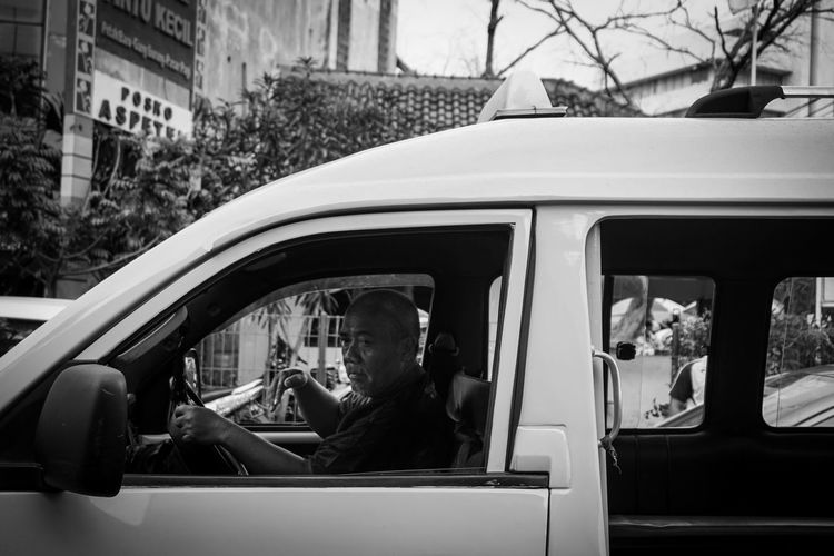 People sitting by car window