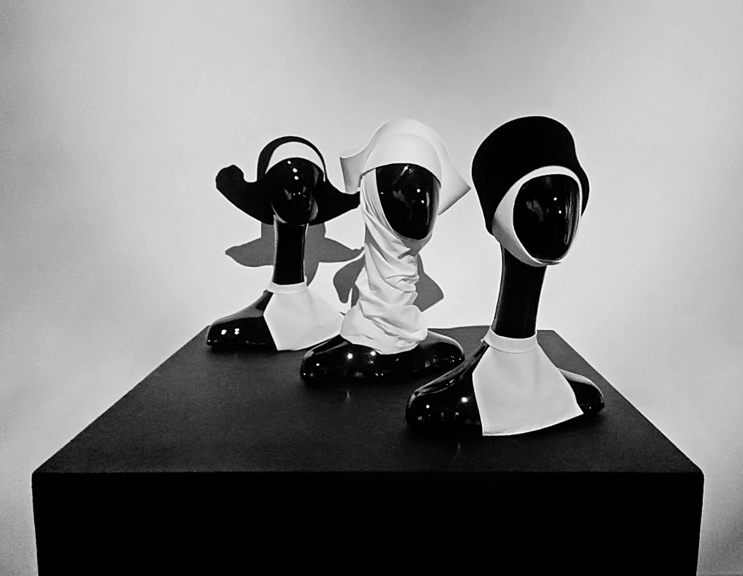 indoors, table, still life, no people, human representation, studio shot, figurine, close-up, representation, sport, arts culture and entertainment, fashion, standing, black color, man made object, wall - building feature, female likeness, man made, paper