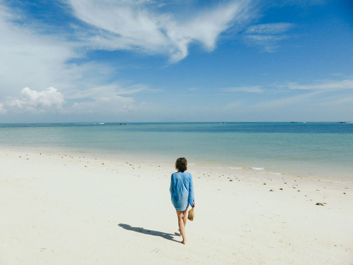 Adult Beach Beauty In Nature Cloud - Sky Day Full Length Horizon Over Water Nature One Person Outdoors People Real People Rear View Sand Sea Sky Water EyeEmNewHere
