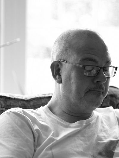 Close-up of mature man at home