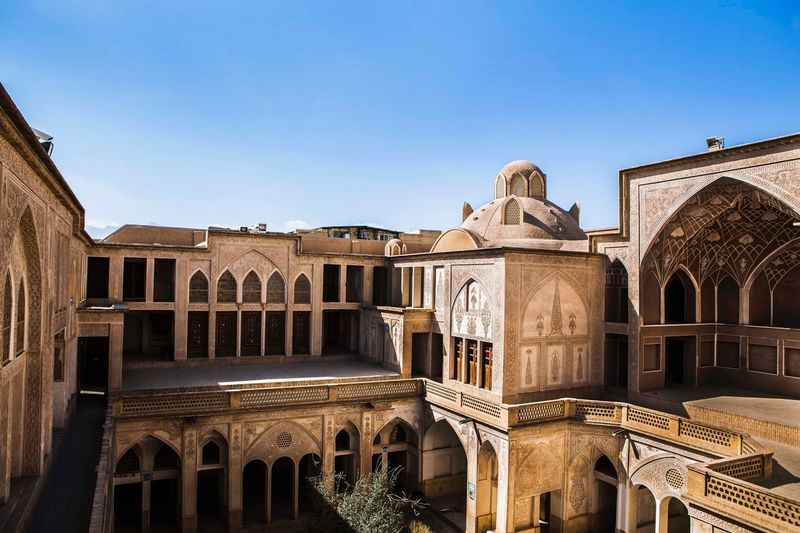 Abbasian house is one of the famous houses in kashan city , I think here is one of the largest houses with a lot of private places and yards for them. This house is belongs to a merchant in safavi period Historical Place Historical Building History Art Arts Culture And Entertainment Iranian Art Iranian_photography Iran Kashan EyeEm Selects Architecture Clear Sky Arch Travel Destinations History No People Sculpture Building Exterior Built Structure Day