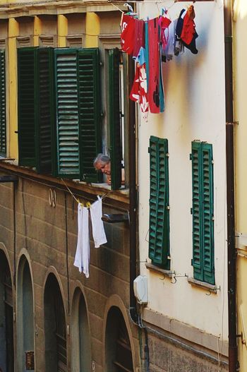 Florence Laundry Day Italian Woman Looking Out Of Window Italian Woman Building Exterior Built Structure Architecture Window Building Laundry