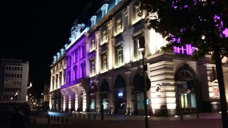 Buildings in city at night