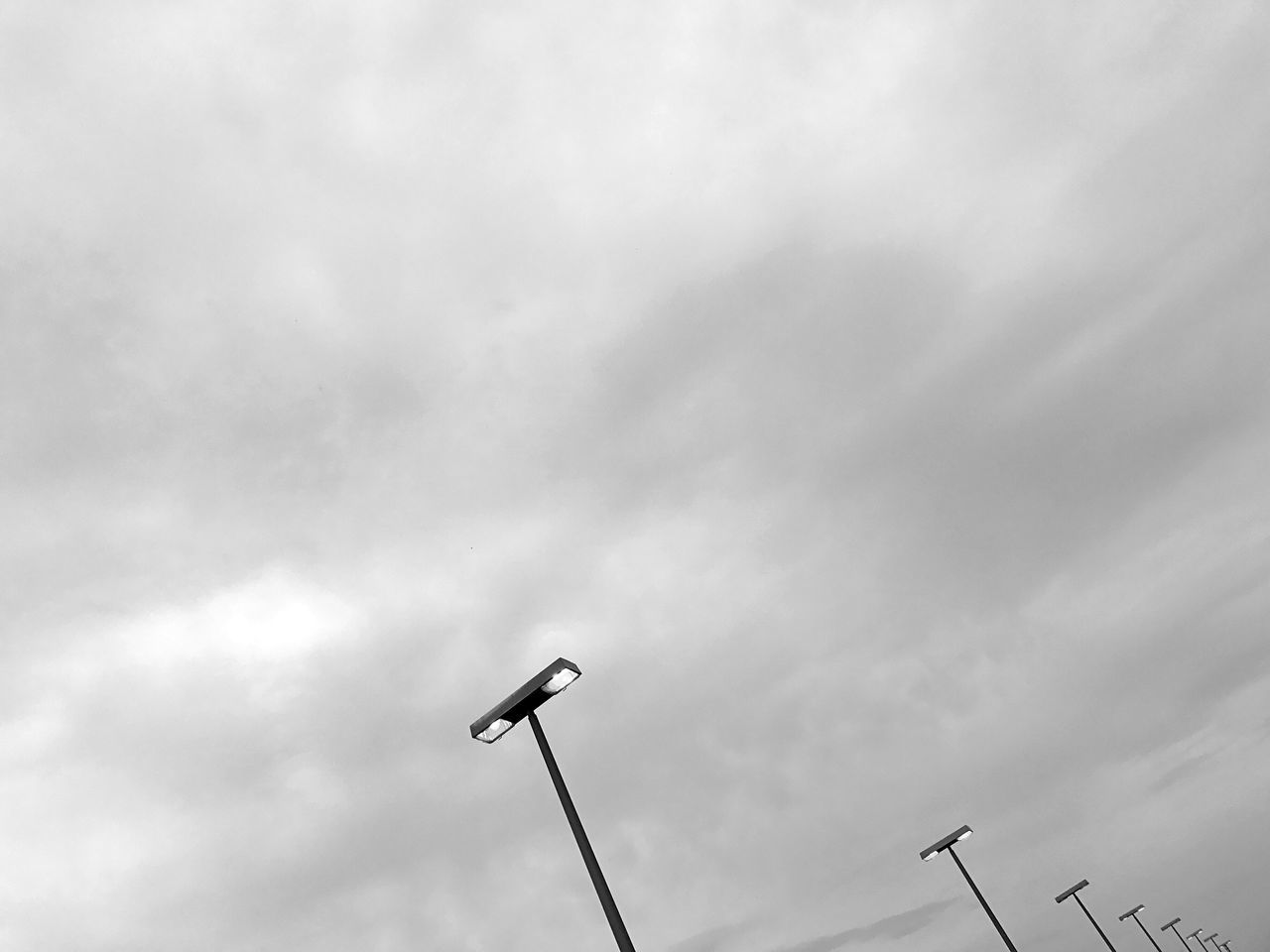 low angle view, communication, technology, sky, day, street light, no people, cloud - sky, outdoors, television aerial, nature