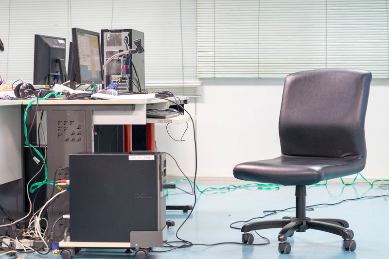 Chair and computer in office