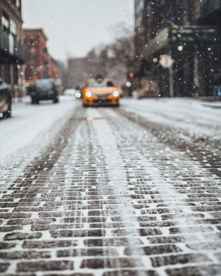 Cars On Street During Snowfall