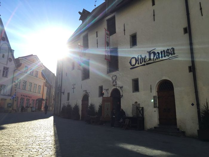 Oldehansa Oldtallinn Estonia Town Restaurant Sun Day Spring Sky Shine Architecture Building Exterior Lens Flare Sunlight Sunbeam Built Structure Outdoors Text City One Person Your Ticket To Europe