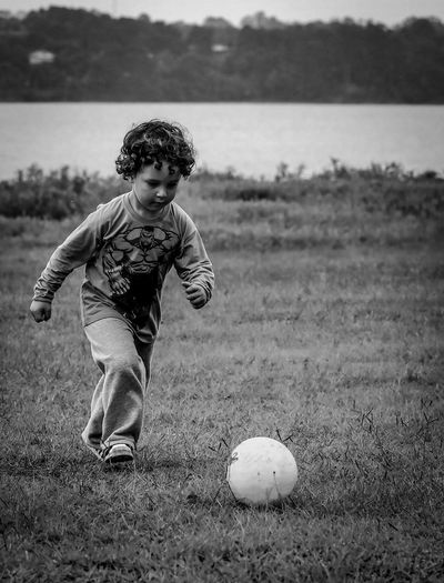 The contagious inspiration of the world cup World Cup 2018 Football Soccer Soccer Player Child Childhood Boys One Person Men Males  Full Length Focus On Foreground Nature Field Innocence Outdoors