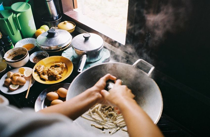 35mm Film Breakfast Day Film Food Food And Drink Freshness Healthy Eating High Angle View Holding Human Body Part Human Hand Indoors  Lifestyles One Person Plate Preparation  Preparing Food Real People Stove Thai Food