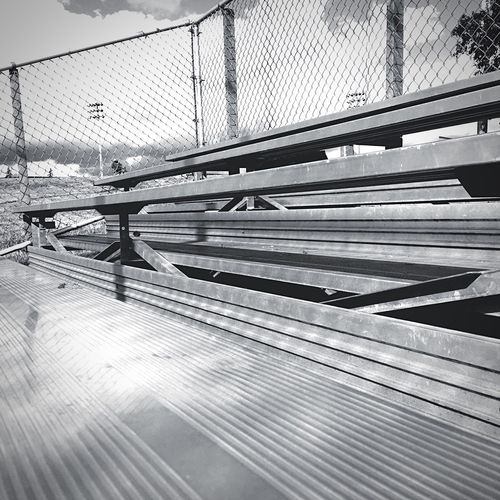 No Fans Empty Bleachers Metal Bleachers Hanging Out Taking Photos Interesting Pictures Perspective Photography Sky And Clouds Black And White Monochrome Photography