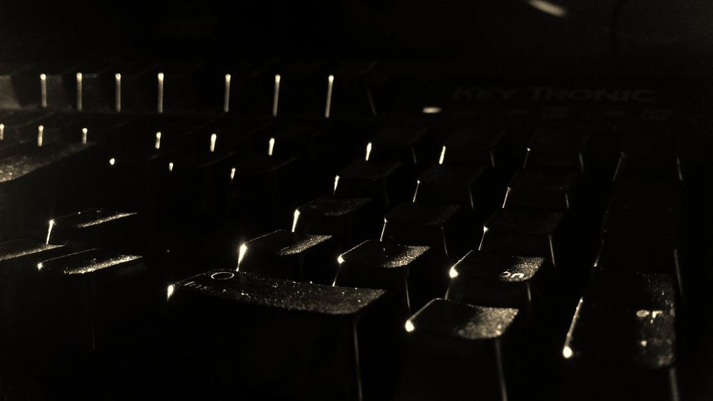Close up of a classic old computer keyboard Typing Technology Dusty Grungy Retro Classic Vintage Old Spacebar Mechanical Monochrome Keyboard Black & White Type Ctrl Key Peripheral Keypad USB Keys Enter B&w Ps2 PC Shift