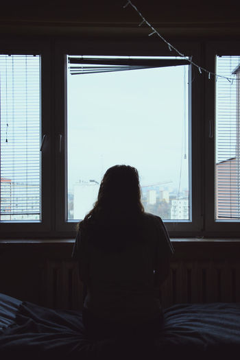 looking through the window Rear View Window One Person Real People Women Indoors  Lifestyles Sitting Glass - Material Leisure Activity Day Home Interior Architecture Looking Through Window Moody Sky Moody Weather Moody