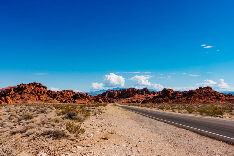 Empty road and rock formations against sky at valley of fire state park