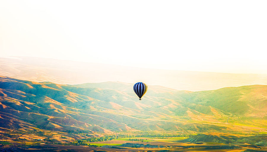 Adventure Aerospace Industry Air Vehicle Ballooning Festival Beauty In Nature Clear Sky Day Flying Hot Air Balloon Journey Landscape Mid-air Mountain Nature No People Outdoors Scenics Sky Sunrise Tranquil Scene Transportation Travel Travel Destinations Vacations