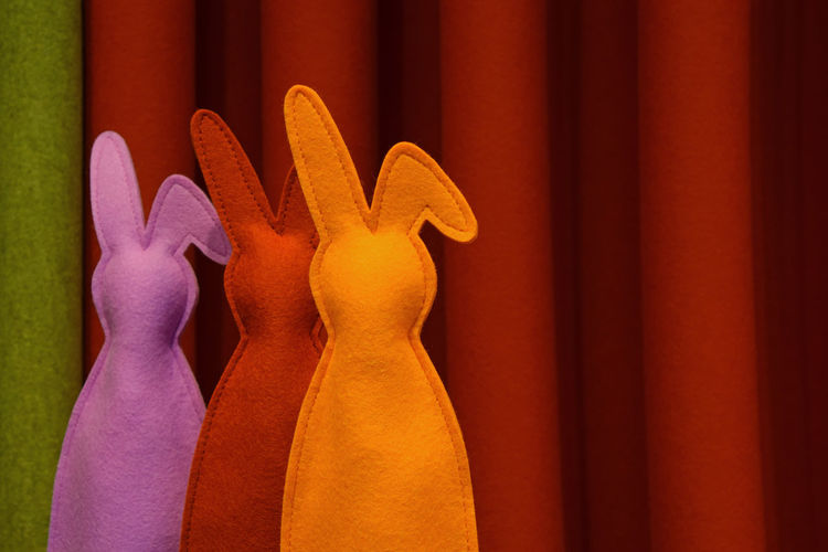 Colorful Easter Bunnies Against Curtain