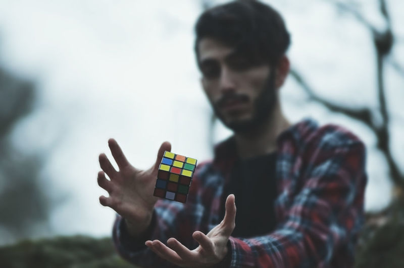 Man Playing With Puzzle Cube