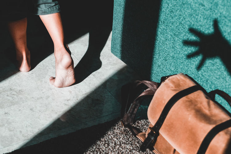 Shadow Play Indoor Feet Passing By Camera Bag Hand Light And Shadows ONA Bags Sunlight Low Section