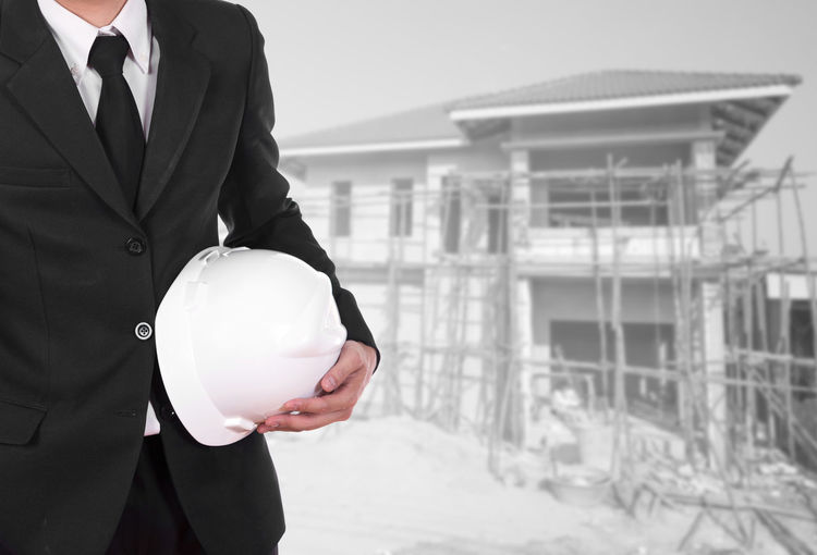 Construction House ARCHITECT Home Site Builder Male Contractor Engineer Building Architecture Worker Work Caucasian Hat Build Engineering Man Men Blueprint Safety Civil Helmet Job Occupation New Roof Housing Industry Concrete Dwelling Property Sky Frame Brick Structure Tile Scaffold Post Exterior Roofing Materials Wall Boss Project Shirt Successful Manager Hard Suit
