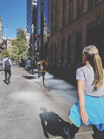 """""""Take my hand will you?"""" Light And Shadow Summer Light Street Photography My Daily Commute People Adult Young Adult Young Women Adults Only Day Outdoors City"""