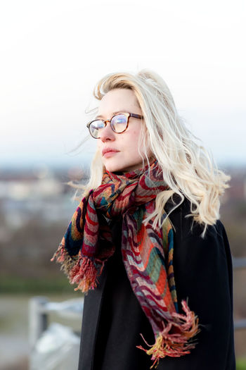 Hair Blond Hair One Person Young Adult Hairstyle Glasses Clothing Adult Women Young Women Beautiful Woman Beauty Front View Portrait Long Hair Standing Lifestyles Eyeglasses  Fashion Scarf Warm Clothing Outdoors Contemplation