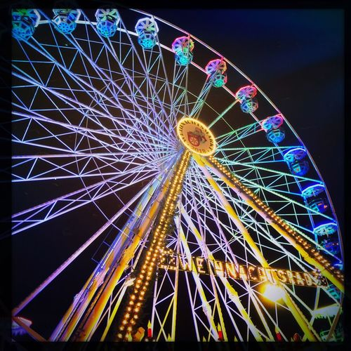 Riesenrad Amusement Park Amusement Park Ride Illuminated Ferris Wheel Arts Culture And Entertainment Night Low Angle View Sky No People Fairground Architecture Outdoors Circle Carnival Auto Post Production Filter Geometric Shape Glowing Built Structure Nature Multi Colored
