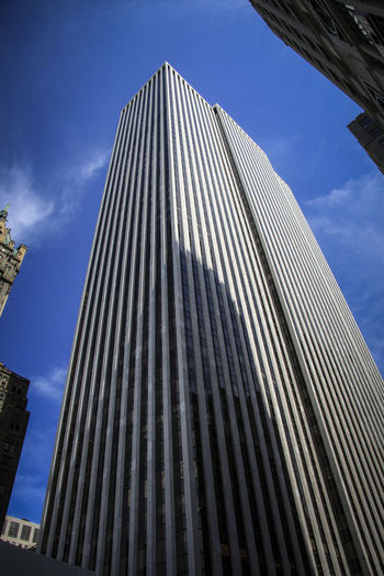 New York Sky Low Angle View Built Structure Architecture Building Exterior Building City No People Office Tall - High Cloud - Sky Modern Nature Day Office Building Exterior Skyscraper Blue Outdoors Pattern Tower