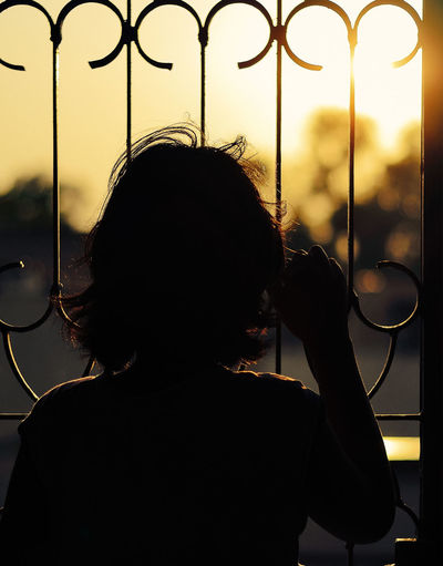 When the world outside beckons! #Evenfall #evening #Golden Hour #Golden Light #Lost In Thought #moments #photo #children #Solitude #sunset #Thoughtful Alone Contemplation Glowing Lens Flare Serious Silhouette