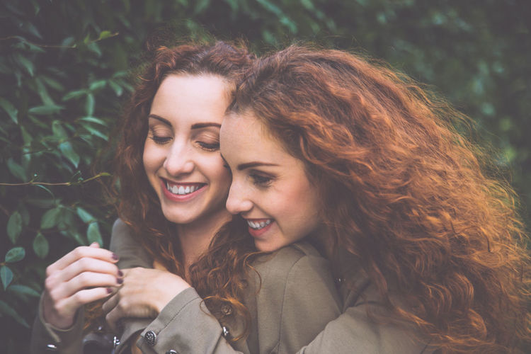 Smiling siblings against plants