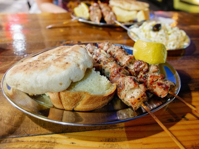 Pork Souvlaki served on a street Food And Drink Food Ready-to-eat Table Plate Snack Meal Meat Wellbeing Fast Food Greek Greece Street Food Souvlaki Athens Pork Bread Pita Bread