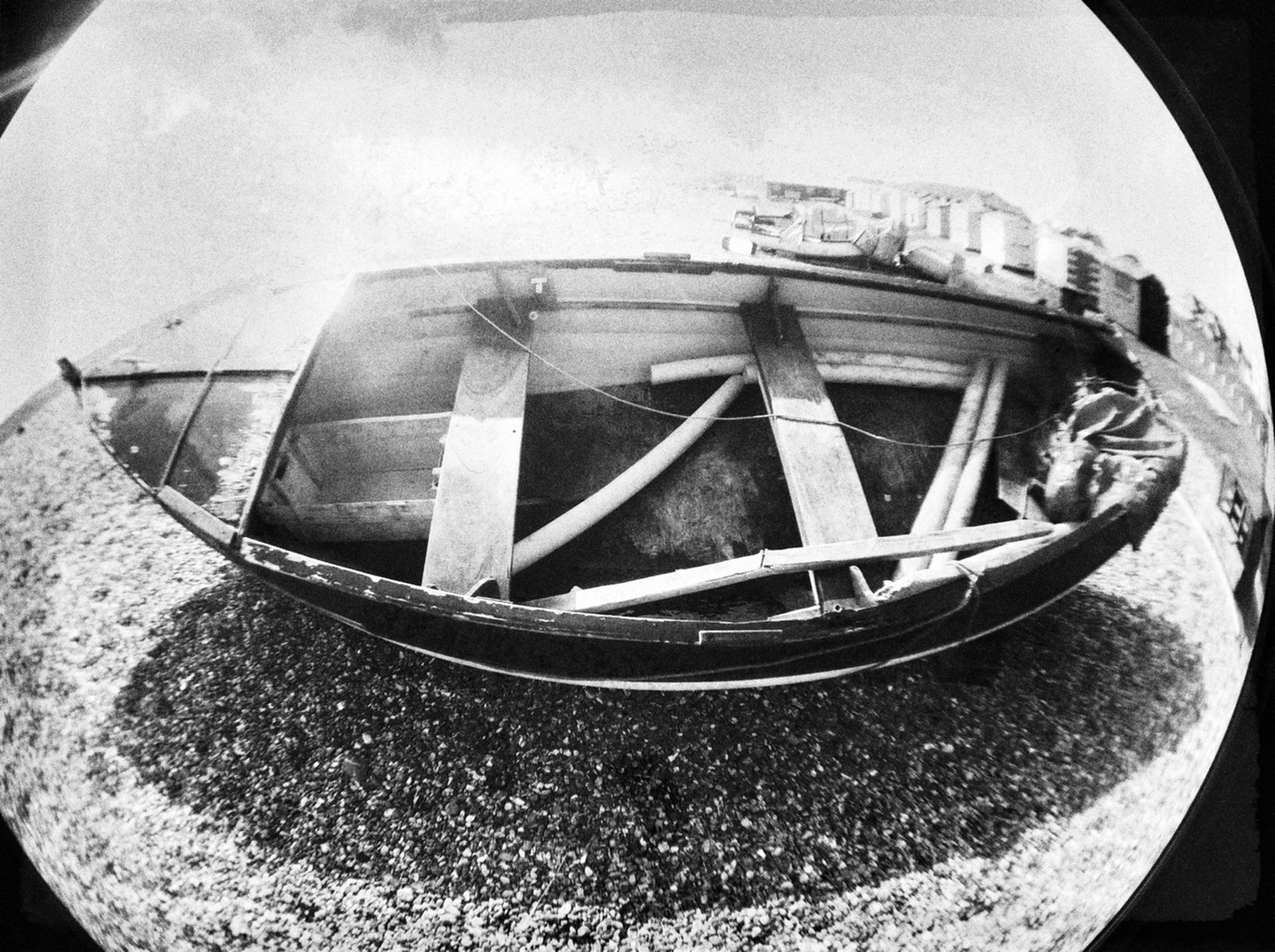 transportation, mode of transport, abandoned, close-up, outdoors, day, sky, nautical vessel, no people, car, boat, obsolete, western script, reflection, clear sky, damaged, text, land vehicle, fish-eye lens, sunlight