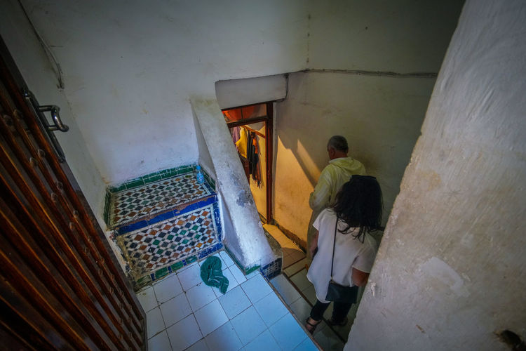 follow Travel Destinations Travel Photography Digital Nomad EyeEmNewHere Morocco Fes Morocco Real People Architecture Indoors  Rear View Built Structure Building High Angle View Men Wall - Building Feature Flooring Standing Full Length Lifestyles Belief Spirituality Domestic Room Tiled Floor