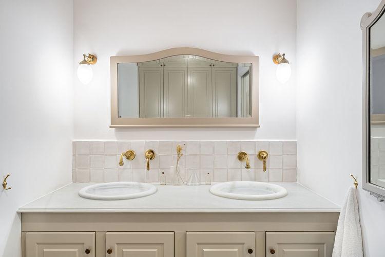Interior of illuminated bathroom at home