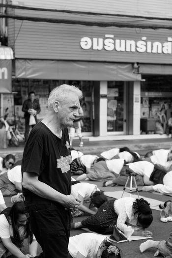 Full length of man sitting at market