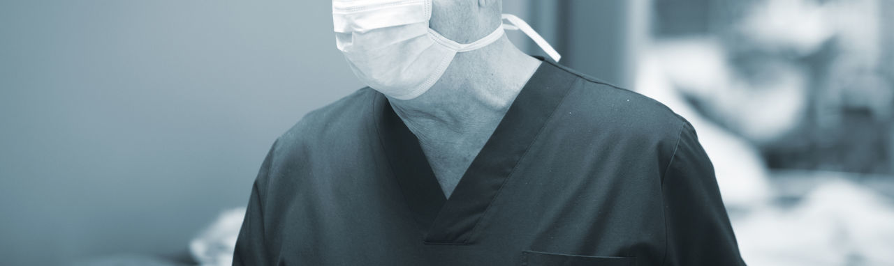 Midsection of senior man wearing surgical mask