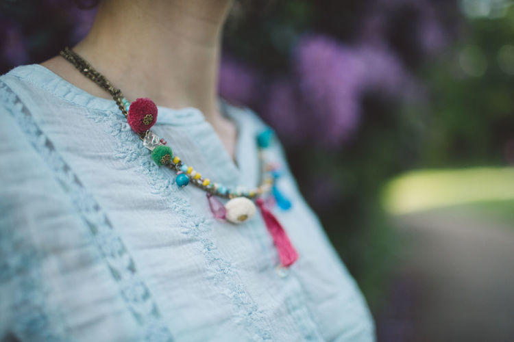 Close-Up Midsection Of Woman Wearing Necklace